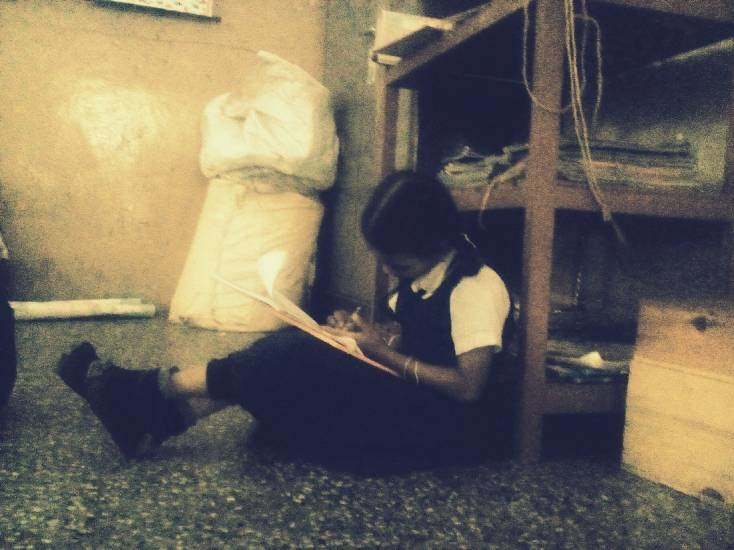Mohini Enjoys coming to School and keeps herself busy with her books